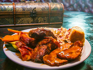 Our World Famour Pirate Barbeque ribs and chicken at sunset